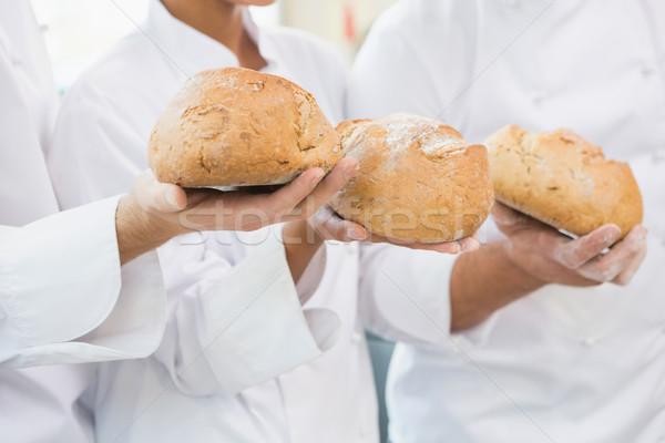 Koledzy bochenek chleba wraz kuchnia Zdjęcia stock © wavebreak_media