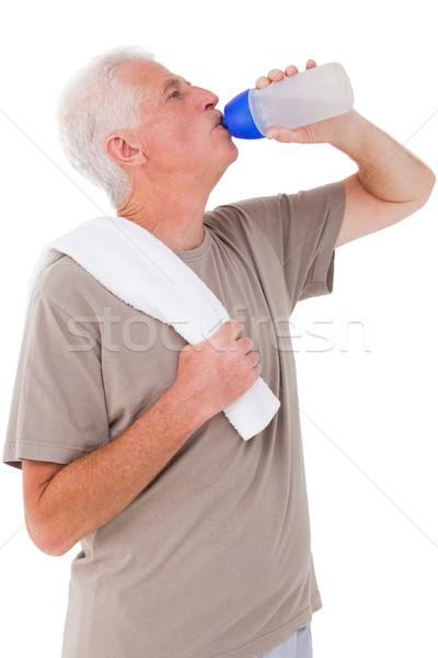 Supérieurs homme potable une bouteille d'eau blanche heureux Photo stock © wavebreak_media