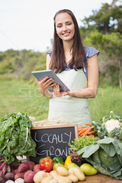 Woman selling organic vegetables at market Stock photo © wavebreak_media