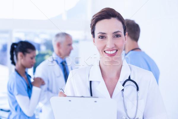 Confident female doctor holding clipboard  Stock photo © wavebreak_media