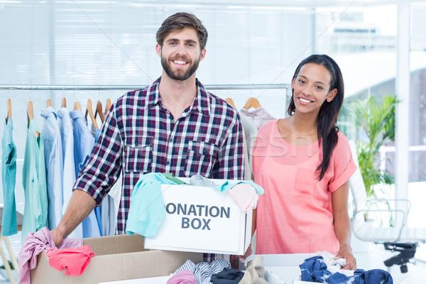 Sonriendo jóvenes amigos voluntarios ropa retrato Foto stock © wavebreak_media