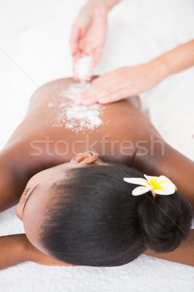 Pretty woman enjoying an exfoliation massage Stock photo © wavebreak_media