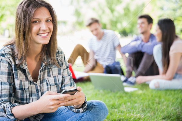 счастливым студентов сидят за пределами кампус университета Сток-фото © wavebreak_media
