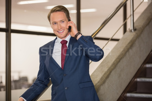 Przystojny biznesmen telefonu biurowiec budynku szkoły Zdjęcia stock © wavebreak_media