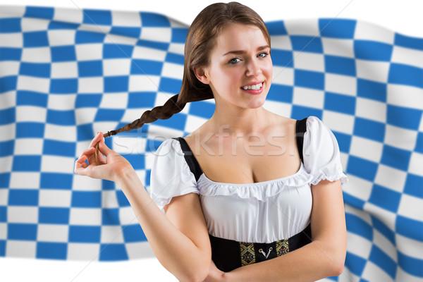 Composite image of pretty oktoberfest girl smiling at camera Stock photo © wavebreak_media