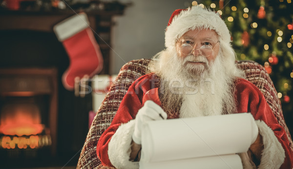 Happy santa writing list with a quill Stock photo © wavebreak_media