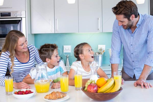 Stock photo: Happy family having breakfast together