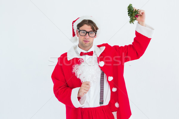 Geeky hipster in santa costume holding mistletoe   Stock photo © wavebreak_media