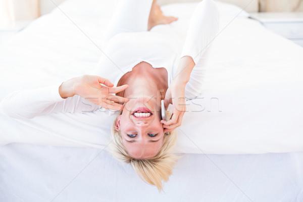 Sorridente mulher loira cama chamada telefone quarto Foto stock © wavebreak_media