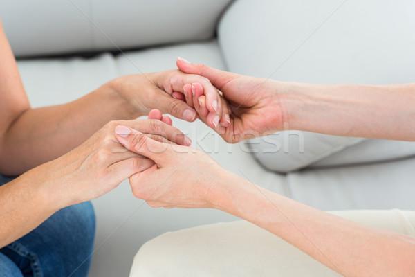 Therapist holding her patients hands Stock photo © wavebreak_media