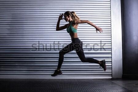 изображение мышечный женщину работает осуществлять Сток-фото © wavebreak_media