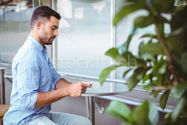 Attentive businessman sending text message Stock photo © wavebreak_media
