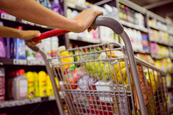 woman buy products with her trolley  Stock photo © wavebreak_media