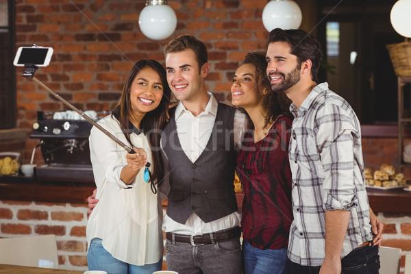 Mosolyog barátok elvesz együtt kávéház férfi Stock fotó © wavebreak_media