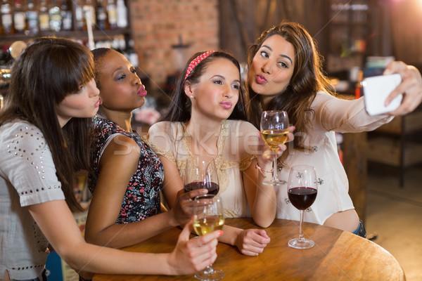Female friends taking selfie while holding wineglasses Stock photo © wavebreak_media