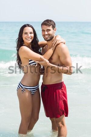 Pareja sesión tabla de surf playa Foto stock © wavebreak_media