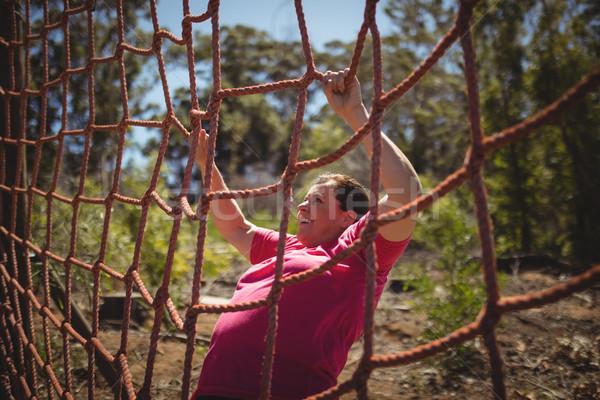 Determinato donna climbing net boot Foto d'archivio © wavebreak_media