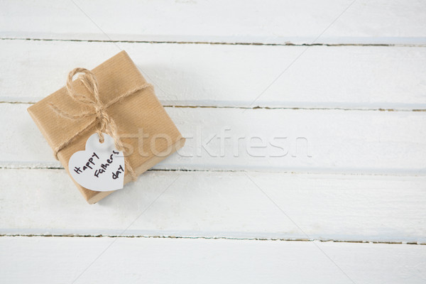 Overhead view of wrapped gift on table Stock photo © wavebreak_media
