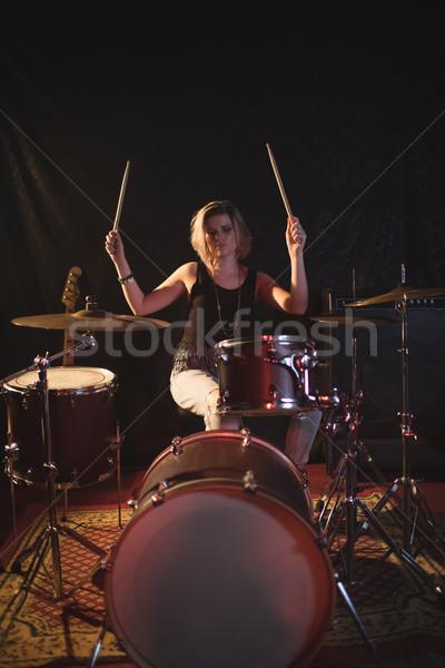 Confident female drummer performing in nightclub Stock photo © wavebreak_media