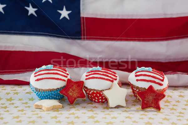 Close-up of decorated cupcakes and cookies arranged on table Stock photo © wavebreak_media