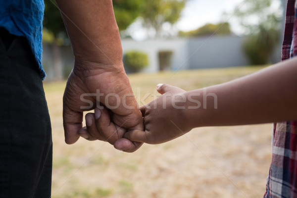 Close up of grandfather and grandson holding fingers Stock photo © wavebreak_media
