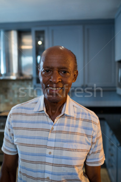 Portrait of senior man standing at home Stock photo © wavebreak_media