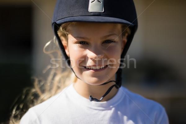 Rider girl smiling in the ranch Stock photo © wavebreak_media