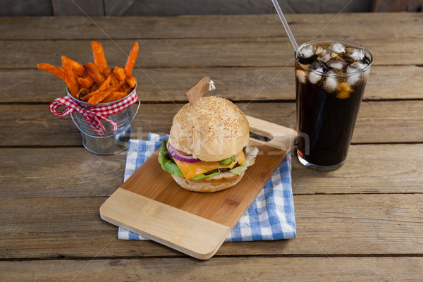 Stock photo: Hamburger, french fries and cold drink on table