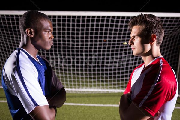 Oldalnézet fiatal férfi futball játékosok néz Stock fotó © wavebreak_media