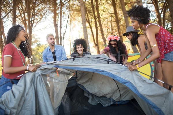 Happy young friends setting up tent Stock photo © wavebreak_media