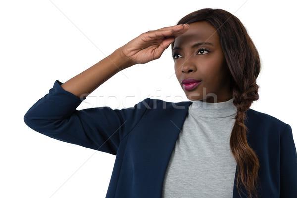 Close up of businesswoman shielding eyes Stock photo © wavebreak_media