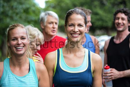 Portrait of senior woman stretching arms with friends Stock photo © wavebreak_media