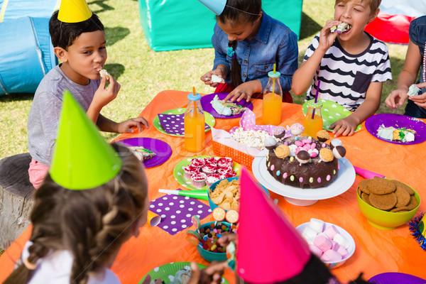 High angle view of children having cake at table Stock photo © wavebreak_media