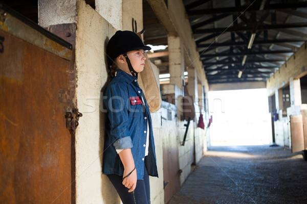 Girl leaning on wall in the stable Stock photo © wavebreak_media