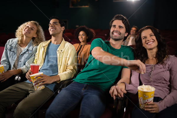 Friends watching movie in theatre Stock photo © wavebreak_media