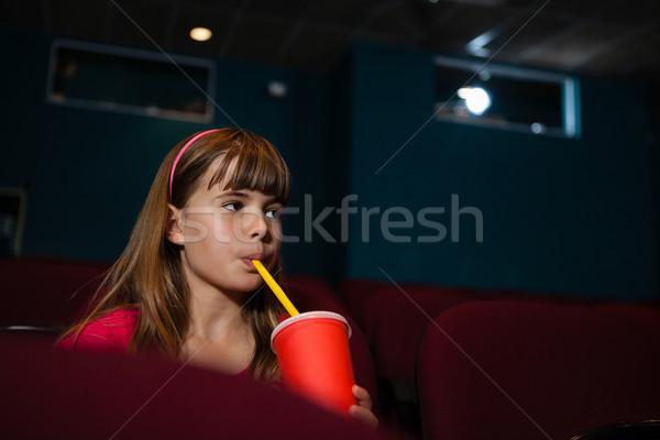Ragazza bere guardare film teatro bambino Foto d'archivio © wavebreak_media