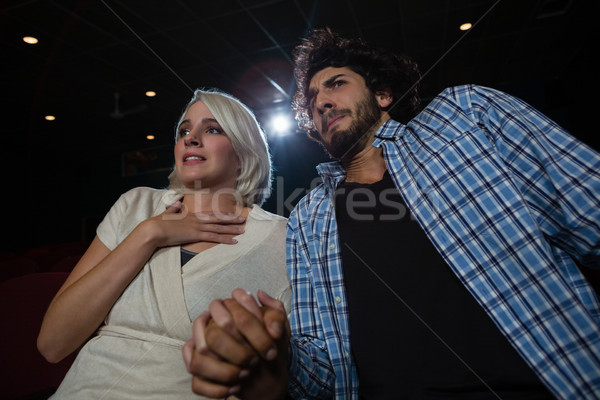 Couple with shocked expression looking at the movie in theatre Stock photo © wavebreak_media