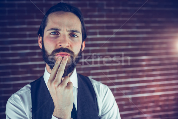 Portrait of thoughtful hipster with hand on chin Stock photo © wavebreak_media