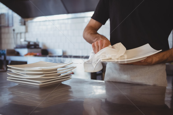 Mid section of waiter cleaning plate in cafe Stock photo © wavebreak_media
