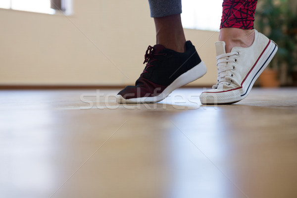 Stock photo: Low section of friends dancing on floor