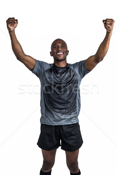 Happy sportsman with clenched fist after victory Stock photo © wavebreak_media