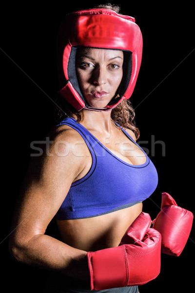 Portrait of pretty boxer with headgear and gloves Stock photo © wavebreak_media