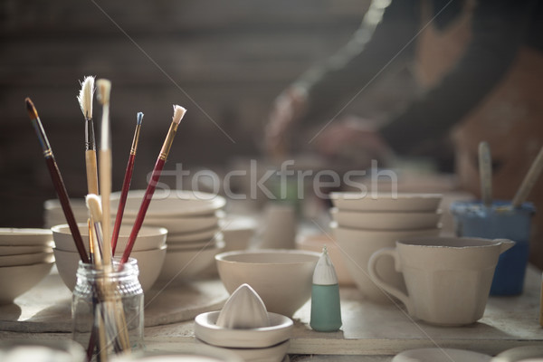 Close-up of various paint brush in pencil holder Stock photo © wavebreak_media