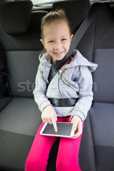 Digital comprimido de volta assento carro Foto stock © wavebreak_media