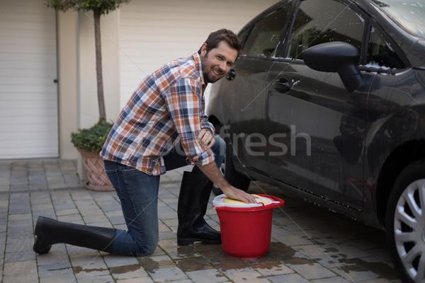 Man washing a car on a sunny day Stock photo © wavebreak_media
