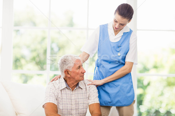 Nurse taking care of sick elderly patient Stock photo © wavebreak_media