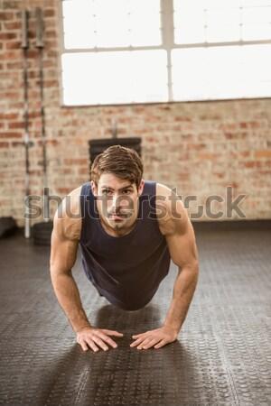 Muscular man planking Stock photo © wavebreak_media