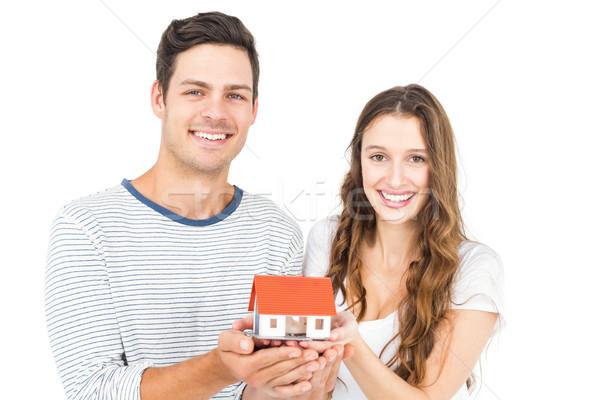 Feliz Pareja miniatura casa blanco Foto stock © wavebreak_media