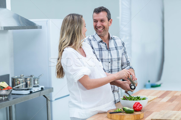 Stock photo: Pregnant couple in kitchen