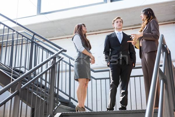 Három cégvezetők áll lépcsőház megbeszél iroda Stock fotó © wavebreak_media